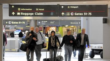 Travelers head to their terminal at the Pittsburgh International Airport. Costs per passenger are increasing for airlines.
