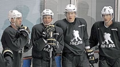 Penguins, from left, Pascal Dupuis, Sidney Crosby, Ben Lovejoy and Tyler Kennedy all wear a sweater displaying NHL Players&#039; Association logo as they pause between drills at an informal workout Thursday at the Iceoplex in Canonsburg.