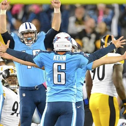 Titans holder Brett Kern (6) celebrates kicker Rob Bironas' winner Thursday against the Steelers in Nashville, Tenn.