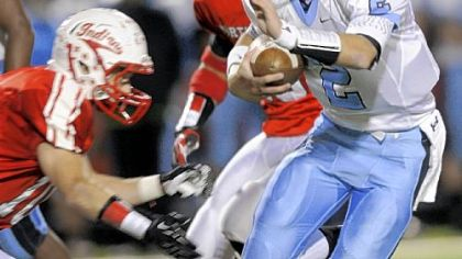 Seneca Valley quarterback Jordan Brown runs the ball in the first half Friday against North Hills in Ross Township. Seneca Valley won, 40-26.