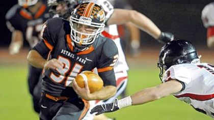 Bethel Park's Zachary Enick carries against Upper St. Clair Friday night.