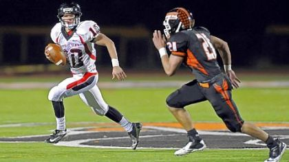 Upper St. Clair quarterback Pete Coughlin scrambles away from Bethel Park's Gary Gerst Friday night at Bethel Park.