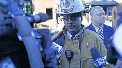 Pittsburgh fire Chief Darryl Jones talks to media Friday at the scene of the fatal Mirror Street blaze. Michael Huss, city public safety director, is at right rear.