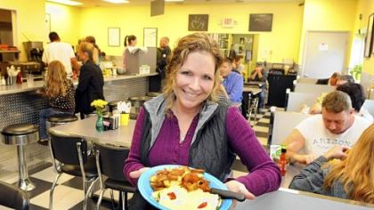 Kelly O&#039;&#039;Connor, owner of Kelly O&#039;s, holds a plate of veggie benedict, one of the popular breakfast dishes available all day at the diner in the Strip District. Another location is in Ross.