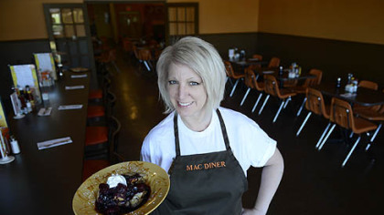 Nancy Sukits, owner of MAC Diner in Hampton, holds creme brule French toast with a berry compote. Her restaurant opened in Over the summer.