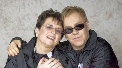 Billie Jean King and Sir Elton John embrace backstage before a WTT Smash Hits event.