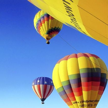 One by one, hot air balloons float into the sky over Albuquerque, N.M.