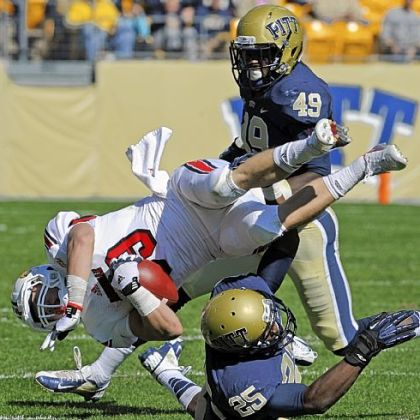 Louisville's Scott Radcliff is upended by Pitt's Jason Hendricks Saturday at Heinz Field. No. 18 Louisville spoiled Pitt's homecoming, riding a big second half to a 45-35 victory.