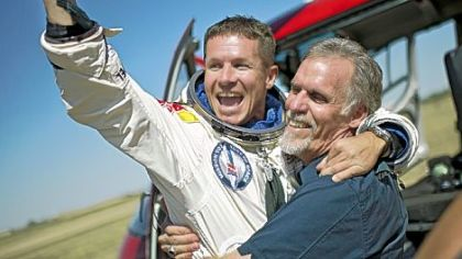 Felix Baumgartner, left, of Austria and technical project director Art Thompson celebrate after Mr. Baumgartner parachuted safely Sunday into the New Mexico desert about nine minutes after jumping from a capsule roughly 24 miles above Earth, breaking the sound barrier during his plunge.