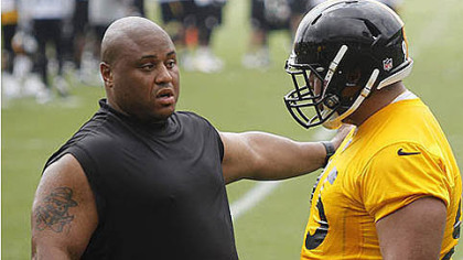 Veteran Casey Hampton, left, explains something to rookie Alameda Ta'amu during the team's minicamp.