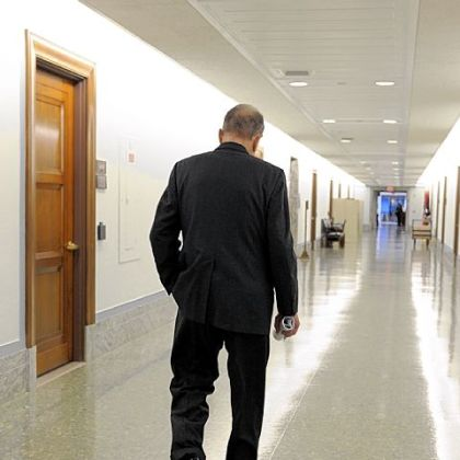 Arlen Specter walks down the hall of the Dirksen Senate office building in 2009.