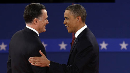 Republican presidential nominee Mitt Romney  and President Barack Obama shake hands tonight at the second presidential debate at Hofstra University in Hempstead, N.Y.