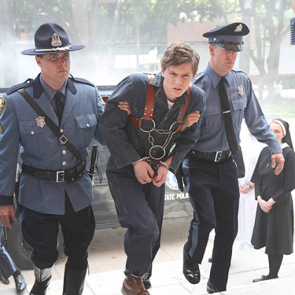 "Evan Peters, center, portrays a man accused of being a serial killer and brought to Briarcliff, an insane asylum, in the second season of FX's ""American Horror Story."""