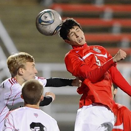 Peters Township&#039;s Nicco Mastrangelo heads ball past Moon&#039;s Brian Frenz Monday at Moon in the Indians&#039; 3-0 win.