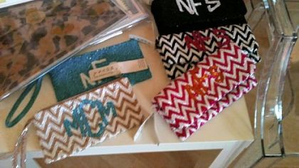 Monogrammed clutch purses in a chevron pattern, $165