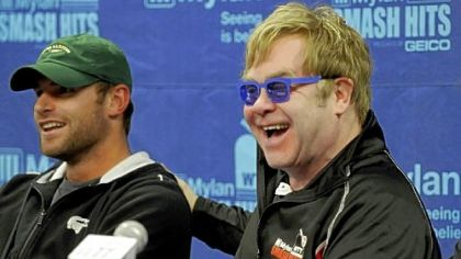 Elton John jokes with Andy Roddick before the start of the Mylan World Team Tennis Smash Hits Tuesday at Petersen Events Center.