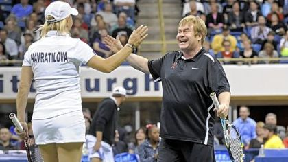 Tennis great Martina Navratilova and Sir Elton John celebrate a win during the Mylan WTT Smash Hits World Team Tennis Match at the Petersen Events Center Tuesday night. The event raised $1 million for the first time in its 20-year history.