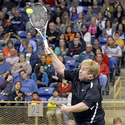 Elton John hits a shot at the Mylan World Team Tennis Match Smash Hits Tuesday at Petersen Events Center.