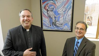 "The Rev. David Peocking and Mark DeAndrea in front of the painting ""Pieta"" done by Mr. DeAndrea's father Frank at St. Elizabeth Ann Seton Church in Carnegie."