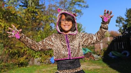 Harmony Ziccardi, 8, shows of her leopard girl Halloween costume outside her home in Pleasant Hills on Tuesday.