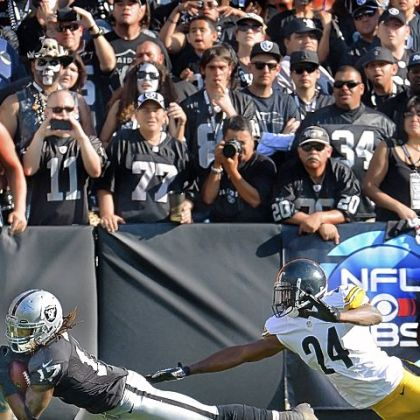 Steelers cornerback Ike Taylor and Raiders receiver Denarius Moore.