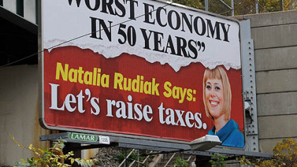 A Lamar billboard at the corner of Warrington and Boggs avenues, with the image of councilwoman Natalia Rudiak.