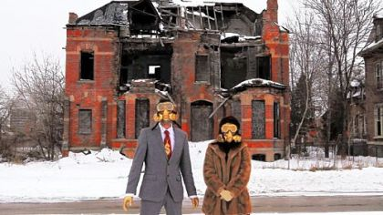 "Performance artists is gas masks use decaying Detroit as a backdrop in a scene from the documentary ""Detropia."""