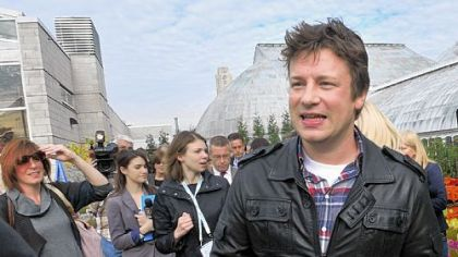Chef Jamie Oliver greets guests Thursday after finishing speaking about his Food Revolution and Pittsburgh's plans to participate in the program at Phipps Conservatory's edible rooftop garden.