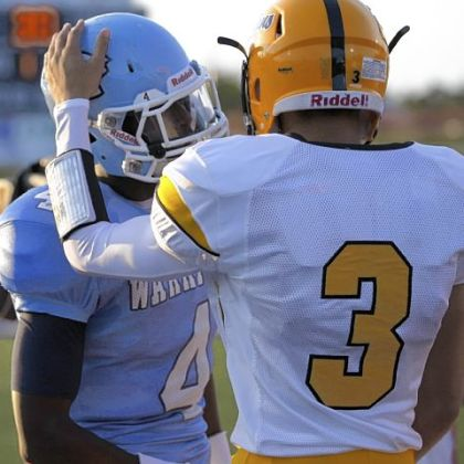 Montour receiver Devin Wilson, right, greets Central Valley receiver Robert Foster before the start of their game earlier this season.