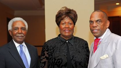 Leon Haley, Mona Generett and the Rev. Glenn Grayson