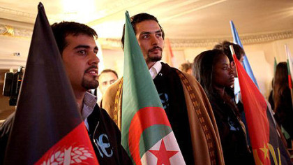 Delegates wait to be announced during the opening ceremony of the  One Young World Conference at Heinz Hall on Thursday.