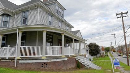 This five-bedroom Victorian in Mount Pleasant features a wraparound porch.