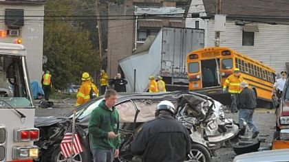A trail of damaged vehicles is seen leading toward a tractor-trailer that lost control early Friday in the West End. Nine vehicles were involved. Three people were hospitalized.