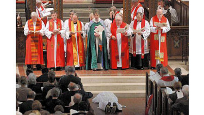 Bishop Dorsey W.M. McConnell prostrates himself during his ordination at Calvary Episcopal Church in Shadyside Saturday.