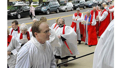 Bishop-elect Dorsey W.M. McConnell, front, processes up the steps to Calvary Episcopal Church in Shadyside for his ordination on Saturday.