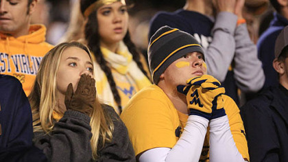 West Virginia fans watch from the stands during the second half.