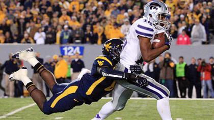 Kansas State&#039;s Tyler Lockett is brought down by West Virginia&#039;s Karl Joseph during the second quarter.