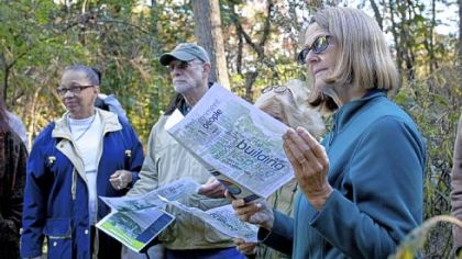 Monica Frolander-Ulf reads about the proposal for the new Frick Park Environmental Center during a nature walk Thursday hosted by the Pittsburgh Parks Conservancy.