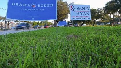 Electoral placards supporting Barack Obama and his Republican rival Mitt Romney are seen near Lynn University in Boca Raton, Fla., where the third and final presidential debate will be held Monday.