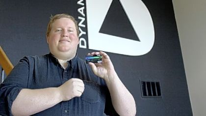 Jeff Mullen, CEO of Dynamics Inc., holds the new ePlate Visa card.