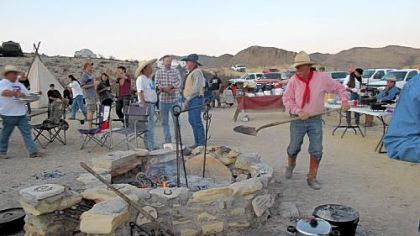 Stoking the fire at Cowboy Camp during the Original Terlingua International Championship Chili Cook-Off in Terlingua, Texas.