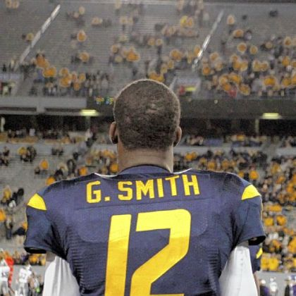 Coach Dana Holgorsen says quarterback Geno Smith is the last person to blame for West Virginia's struggles.