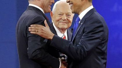 Moderator Bob Schieffer, center, watches as the candidates shake hands before the start of the debate.