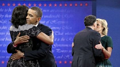 First Lady Michelle Obama, left, hugs President Barack Obama as Ann Romney, right, hugs Republican presidential candidate Mitt Romney at the end of the third and final presidential debate Monday at Lynn University in Boca Raton, Fla.