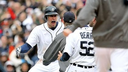 Don Kelly celebrates with teammates after he hit the winning sacrifice fly in the bottom of the ninth inning against the Oakland Athletics in Game 2 of the American League Division Series.