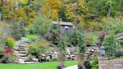 A rustic stone wall divides the back of the Romboski garden into two levels.