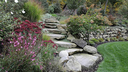 The stone steps and wall in the garden of Rose Romboski.