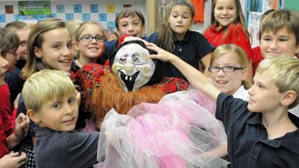 Fourth-graders from Kelly Ryan's class at St. Sebastian School in Ross assemble scarecrows at the school last week.