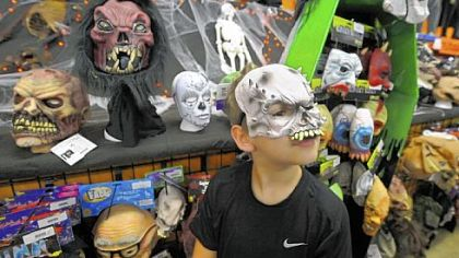 A face in the crowd, Gage Clark, 10, models a mask he picked out at Dreams to Screams Halloween Super Store, North Versailles.