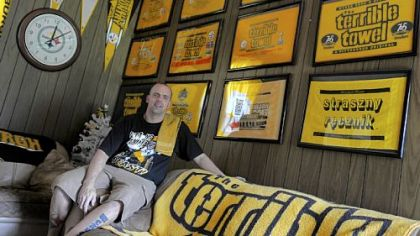 Bryan Wassel with his large collection of Terrible Towels, in his Irwin home.